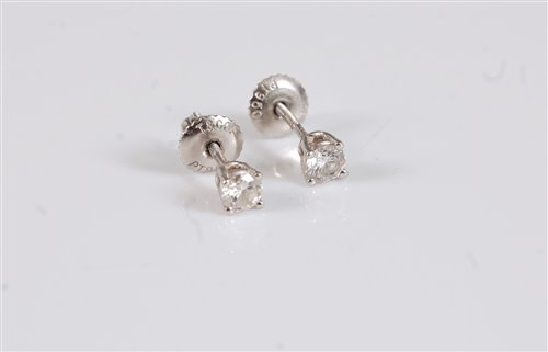 Lot 2617 - A pair of platinum Tiffany diamond earstuds,...