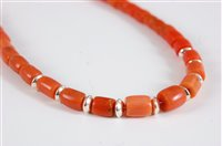Lot 2570-A coral bead necklace, the barrel shaped beads...