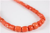 Lot 2571-A coral bead necklace, the barrel shaped beads...