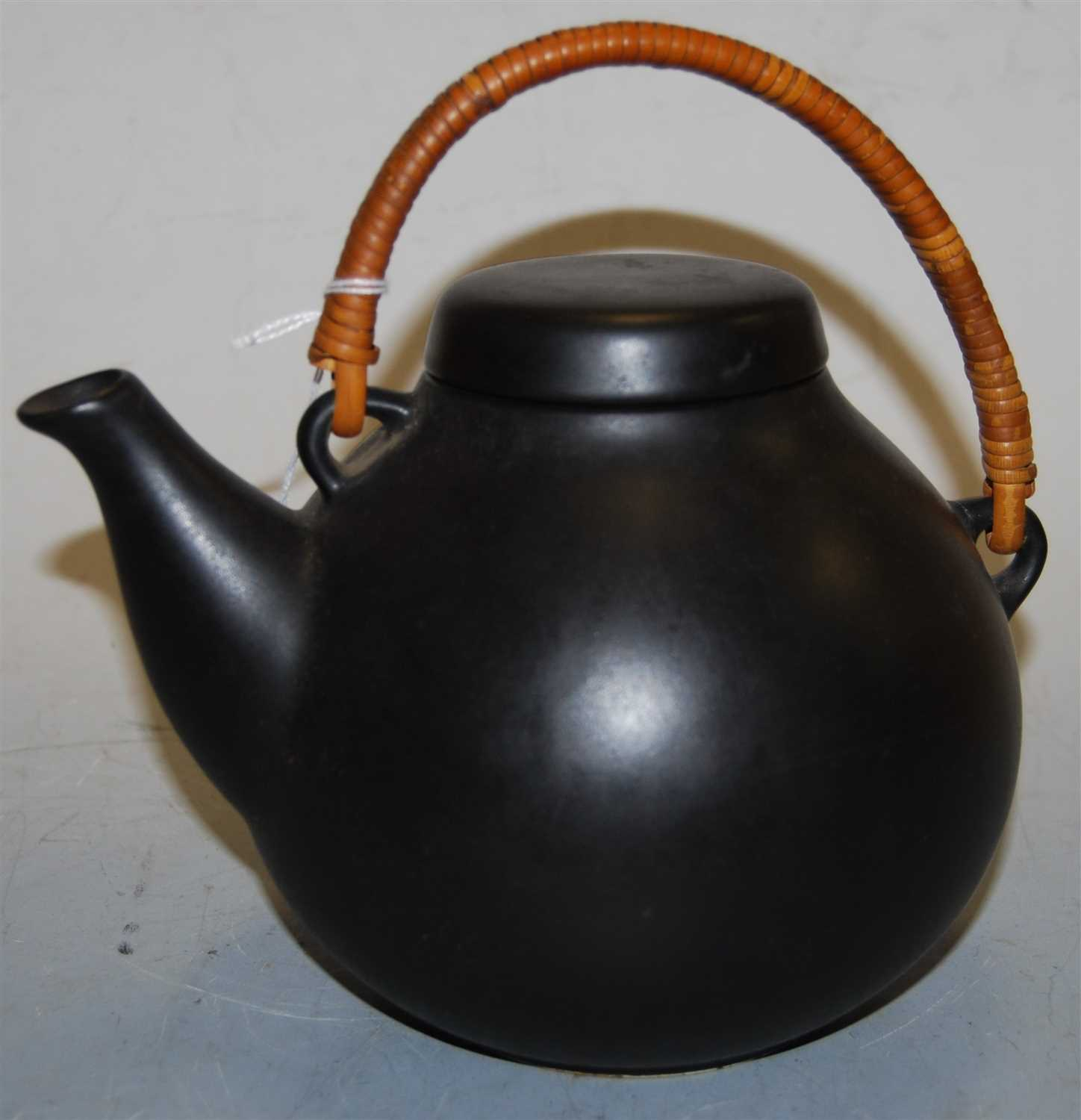 Lot 2-An Arabia ceramic teapot and cover, on a black...