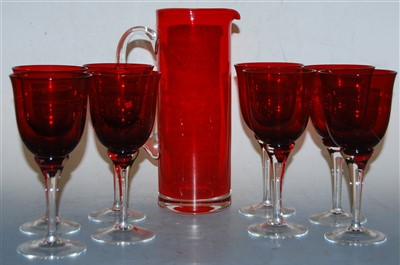 Lot 4-A set of eight ruby glass wine goblets; together...