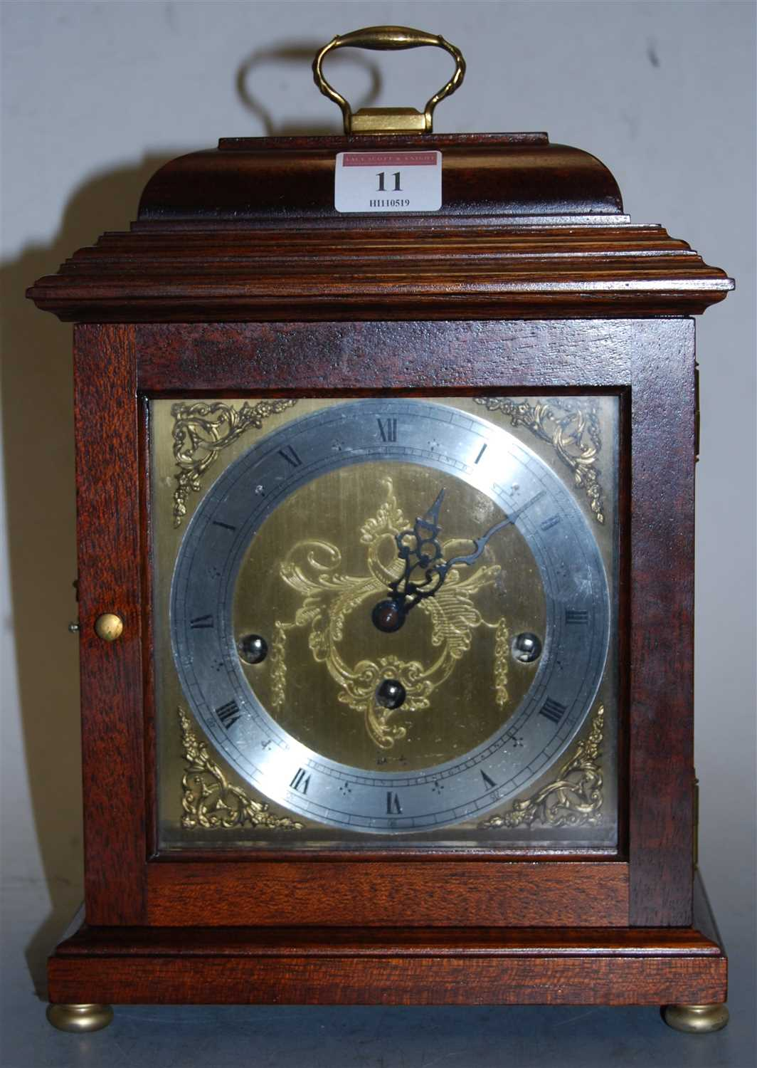 Lot 11-A modern mahogany cased mantel clock, the...