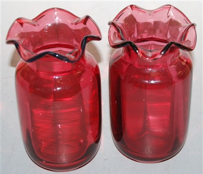 Lot 19-A pair of cranberry glass vases, each having a...