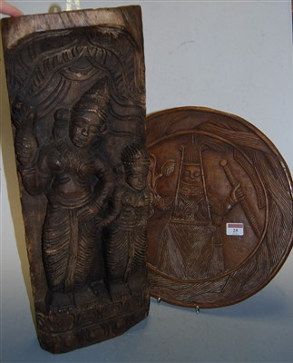 Lot 25-An oak panel, relief carved with a deity;...