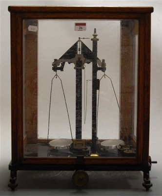 Lot 26-A set of laboratory scales and weights in glazed...