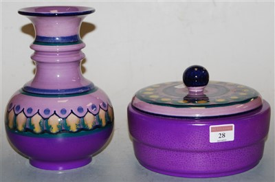 Lot 28-A Lila Flora Dutch pottery vase, on a purple...