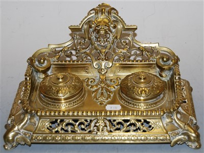 Lot 29-A Victorian style brass desk stand, the pierced...