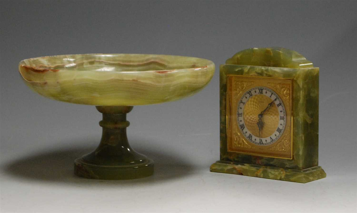 Lot 24-A mid-20th century onyx cased mantel clock,...