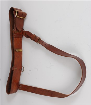 Lot 24-A brown leather Sam Browne belt with brass fittings.