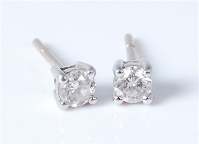 Lot 2569-A pair of white metal diamond ear studs, the four ...