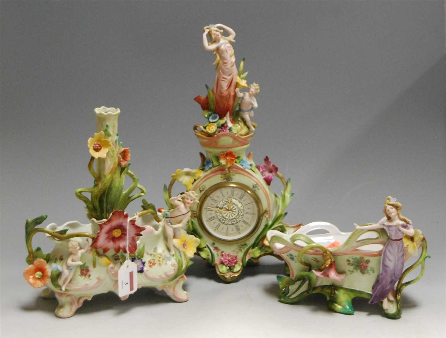 Lot 3-A German porcelain cased mantel clock, having a...