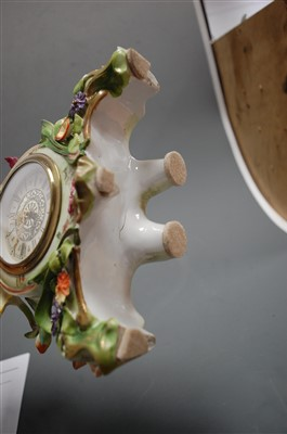 Lot 3-A German porcelain cased mantel clock, having...