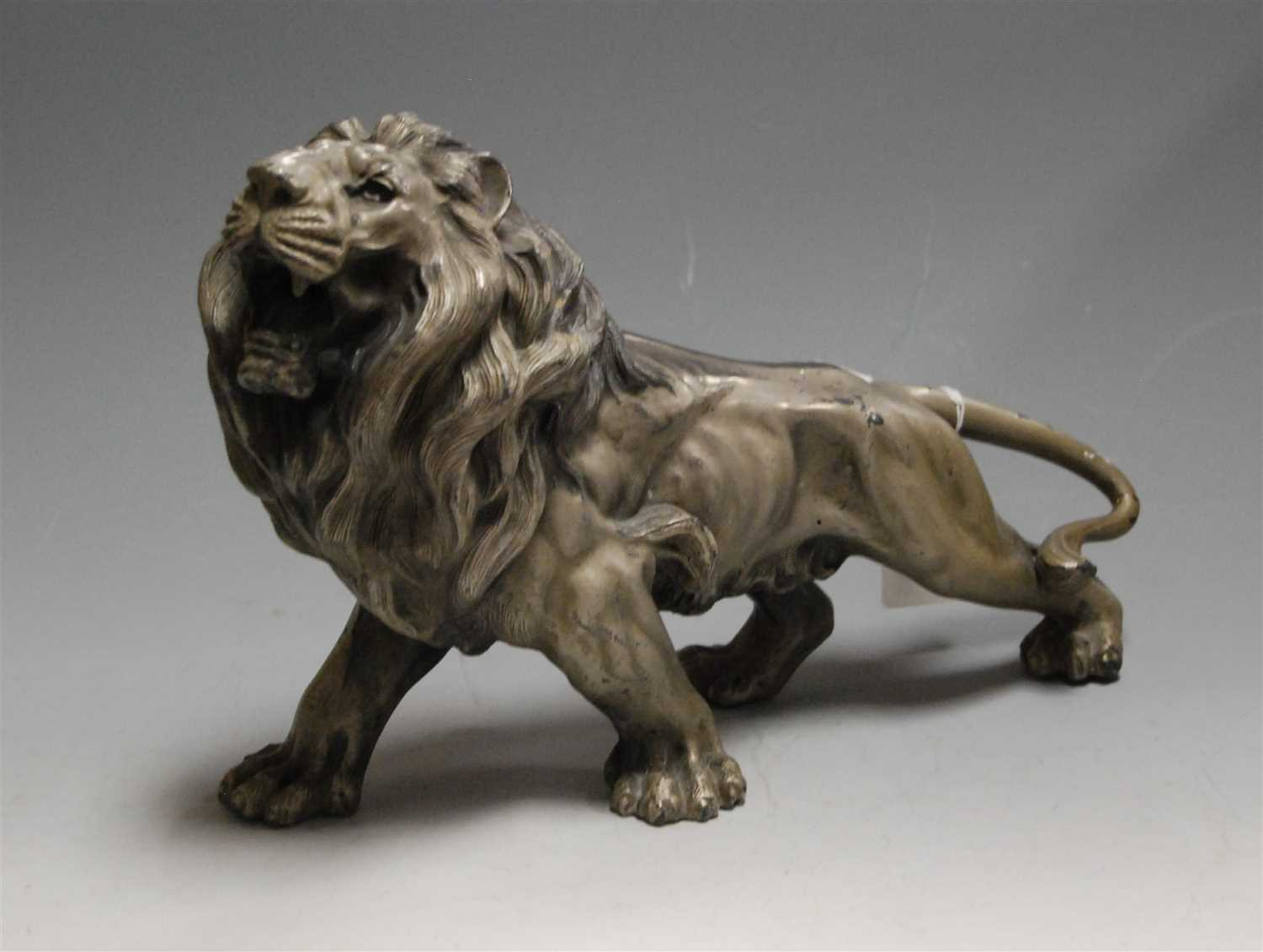 Lot 9-A large Spelter figure of a lion, in roaring pose,...