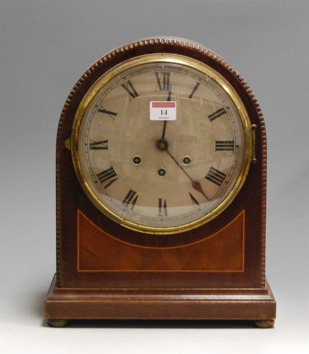 Lot 14-A 1920s mahogany cased dome-top mantel clock,...