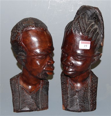 Lot 19-A pair of African carved hardwood tribal busts, h....