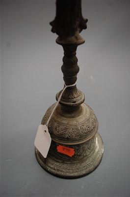 Lot 20-A Tibetan brass hand-bell, having all-over floral ...
