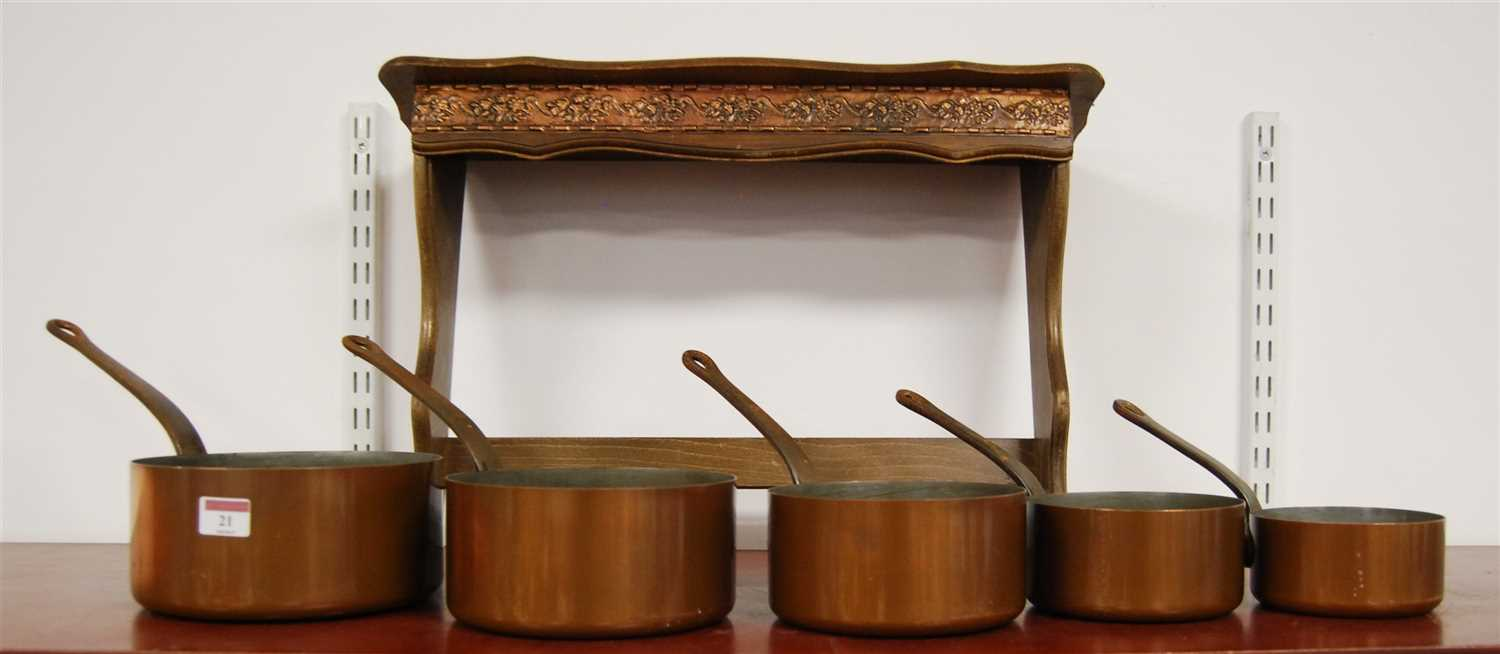 Lot 21-A graduated set of five copper saucepans;...