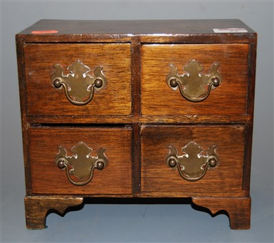 Lot 25-A mahogany four drawer table-top jewellery...