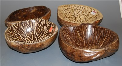 Lot 28-A set of four coconut husk table bowls
