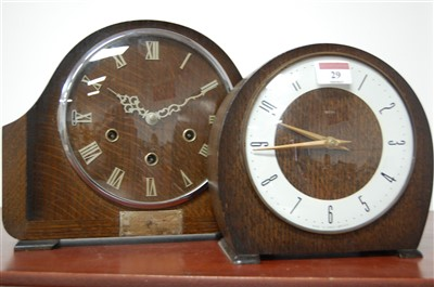 Lot 29-A 1950s Smiths oak cased mantel clock, having...