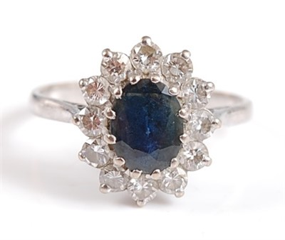 Lot 2501-A 9ct white gold and sapphire oval cluster ring,...