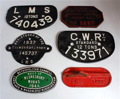 Lot 15-Six various cast iron railway wagon plates and...