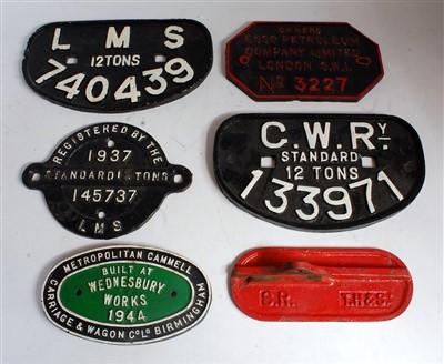 Lot 15-Six various cast iron railway wagon plates and...