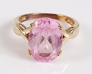 Lot 2504-An oval synthetic pink sapphire dress ring, claw...