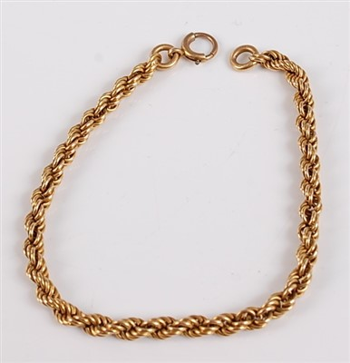 Lot 2510-A yellow metal twisted rope link bracelet, with...