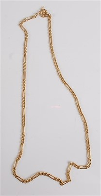 Lot 2511-A yellow metal fetter and three link neck chain,...