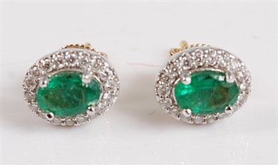 Lot 2506-A pair of 18ct yellow and white gold oval emerald ...