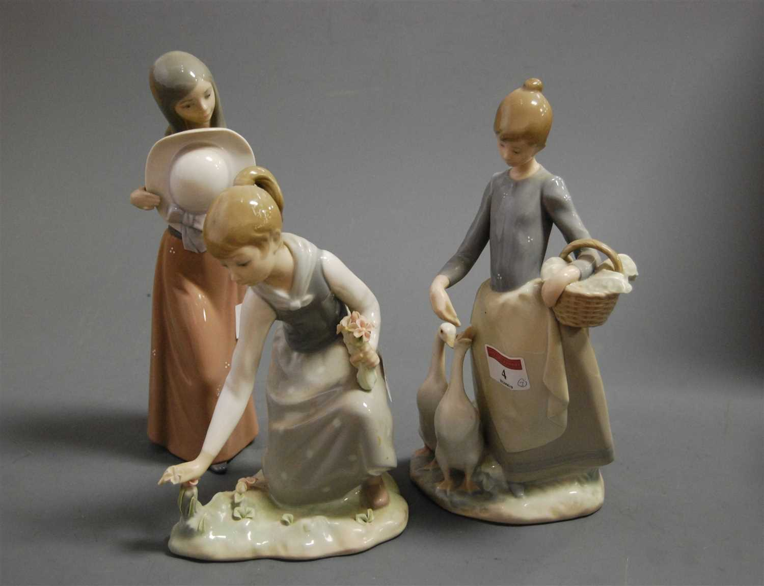 Lot 4-A Lladro porcelain figure of a girl feeding geese,...