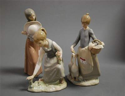Lot 4-A Lladro porcelain figure of a girl feeding...