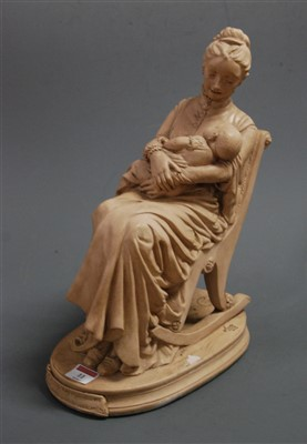 Lot 11-A reproduction earthenware figure of a mother and ...