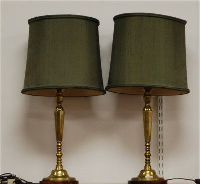 Lot 14-A pair of contemporary turned brass table...