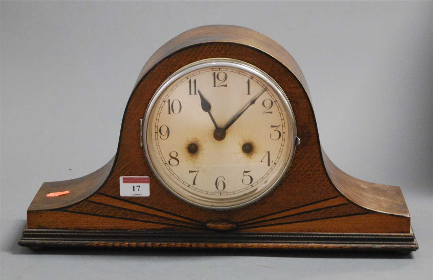 Lot 17-A 1930s oak cased mantel clock having a...