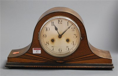 Lot 17-A 1930s oak cased mantel clock having a silvered...