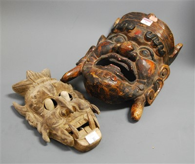 Lot 30 - A large carved softwood and painted tribal...