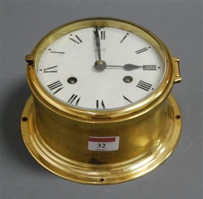Lot 32 - A continental brass cased ships bulkhead clock,...