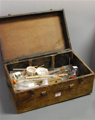 Lot 40-An early 20th century pine box containing various ...