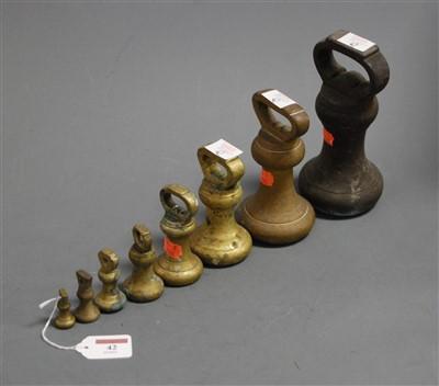 Lot 42-Eight graduated brass bell weights