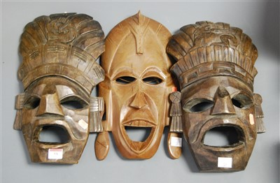 Lot 59-A carved softwod tribal wall mask; together with...