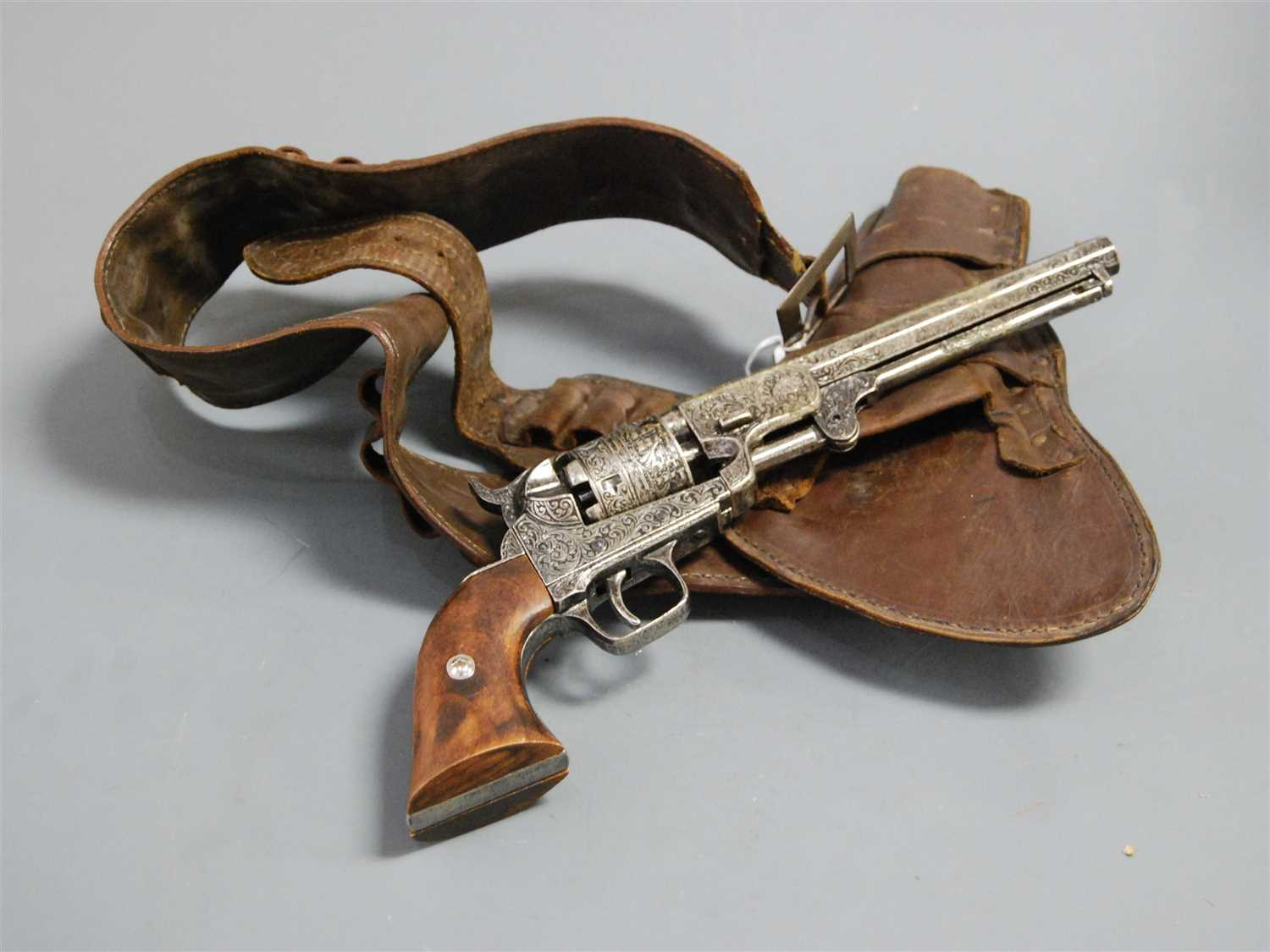 Lot 36-A reproduction model of a Colt revolver, having...