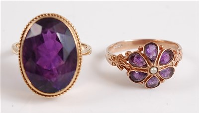 Lot 2520-A pair of 9ct gold amethyst rings, one consisting ...