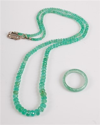 Lot 2524-An emerald necklace, the 210 graduated faceted...