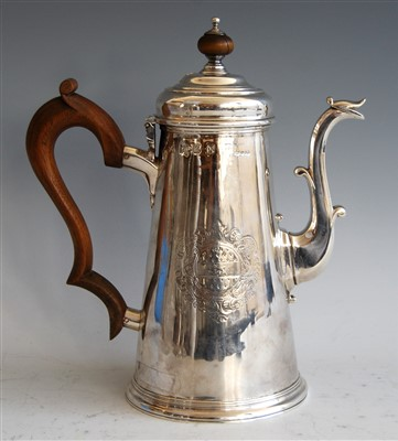 Lot 1066 - A silver coffee pot, 18th century with later...