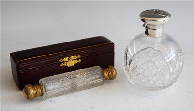 Lot 1078 - An Edwardian cut glass and silver topped scent...
