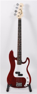 Lot 609-A Benson precision bass guitar, in red boxed as new