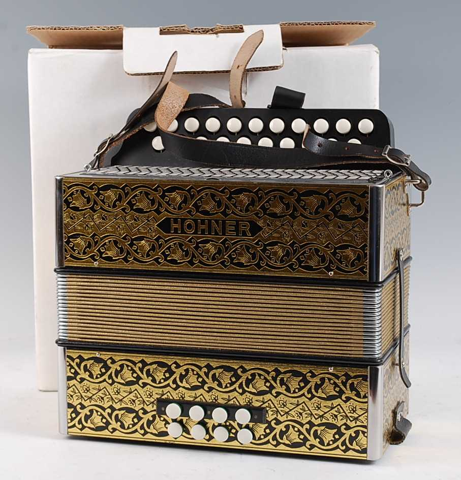 Lot 614-A modern Hohner Erica 21 button accordion, boxed.