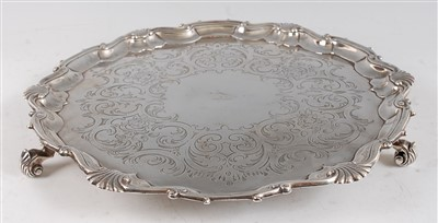 Lot 1079 - A George II silver salver, having floral and C-...